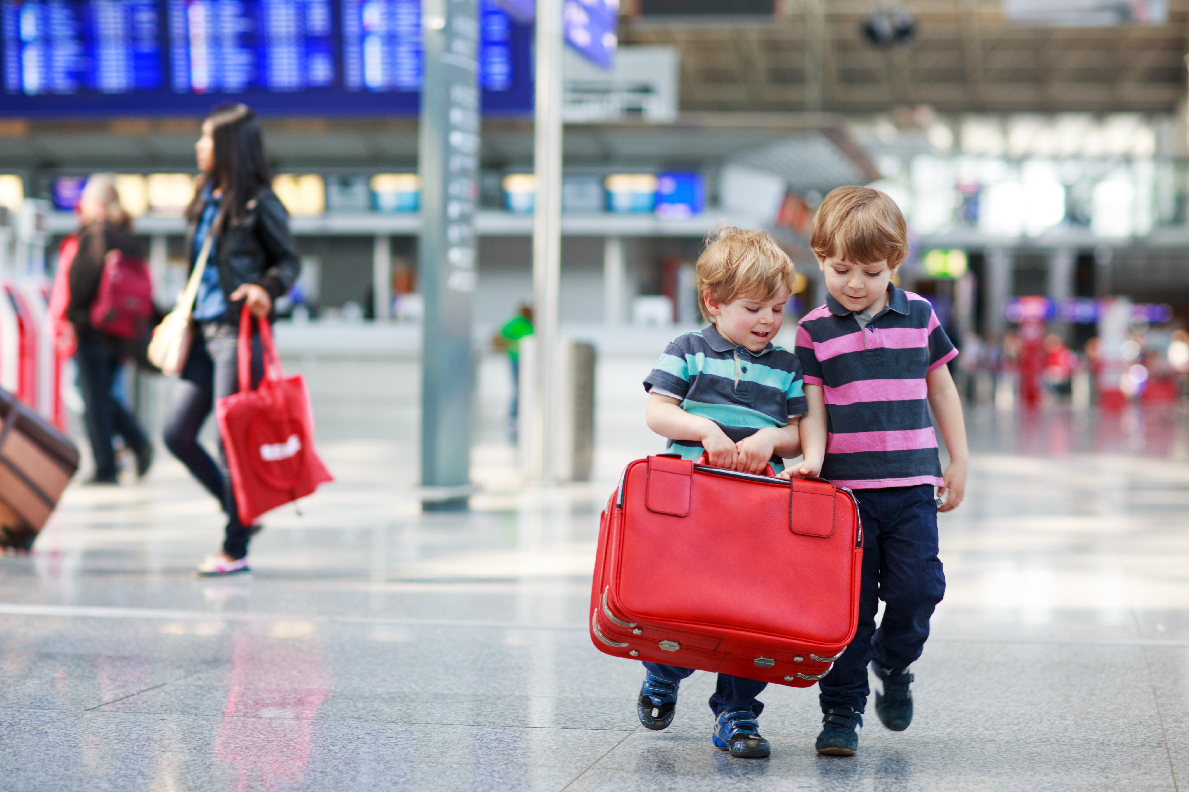 Young boys with red suitcase