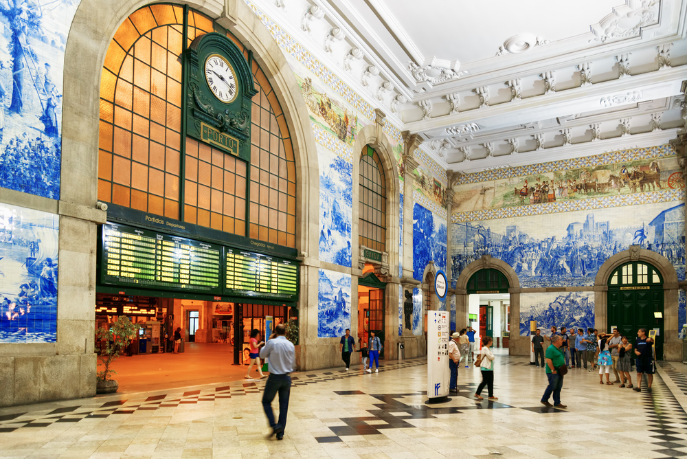 The striking interior of the São Bento railway station in Porto - Credit: Shutterstock
